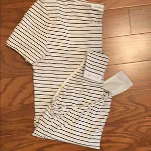 Black and white striped body suit.